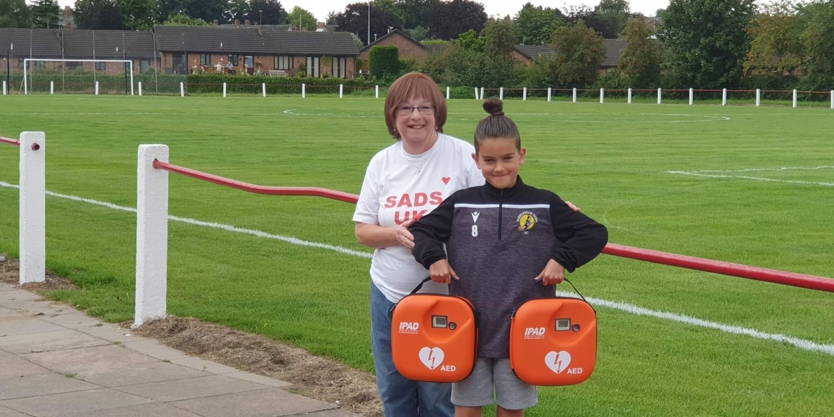 SADS UK praises Bayley for raising funds for 2 Defibrillators at Middlewich Town FC